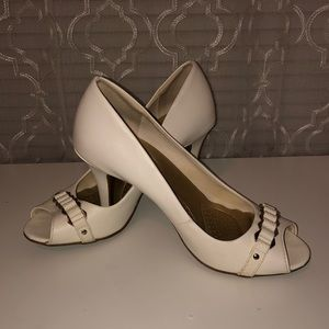 White Pair of Faux Leather Heels